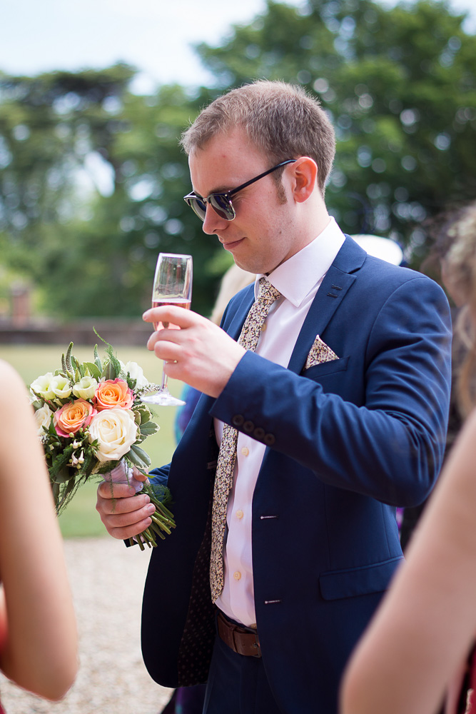 confused wedding guest holding a bouquet