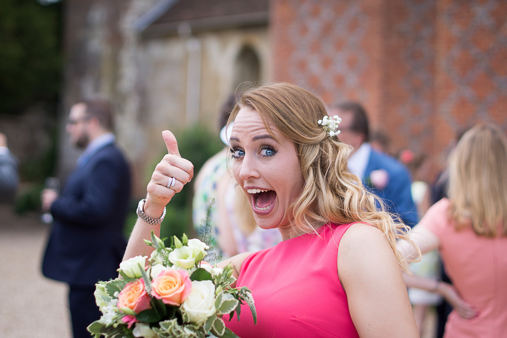 colour of bridesmaid with thumb up