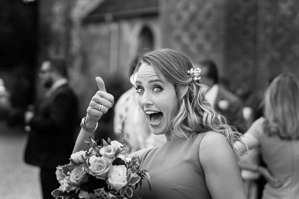 black and white bridesmaid thumb up