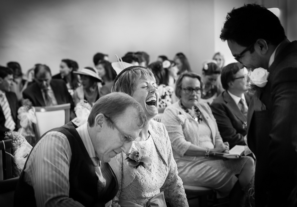 laughing moter of the groom black and white