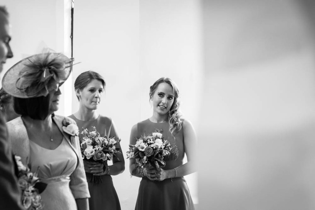 emotional black and white image of the bridesmaid
