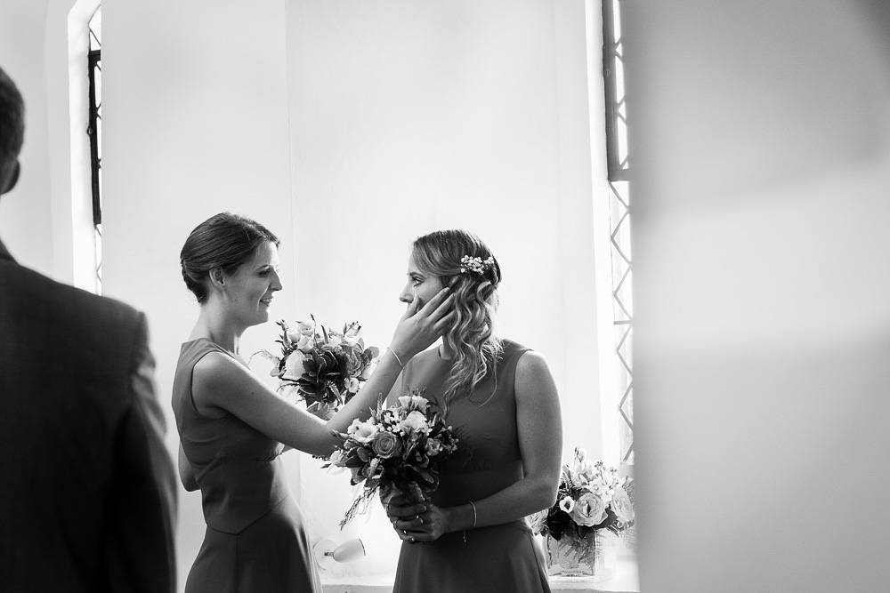 black and white bridesmaids crying