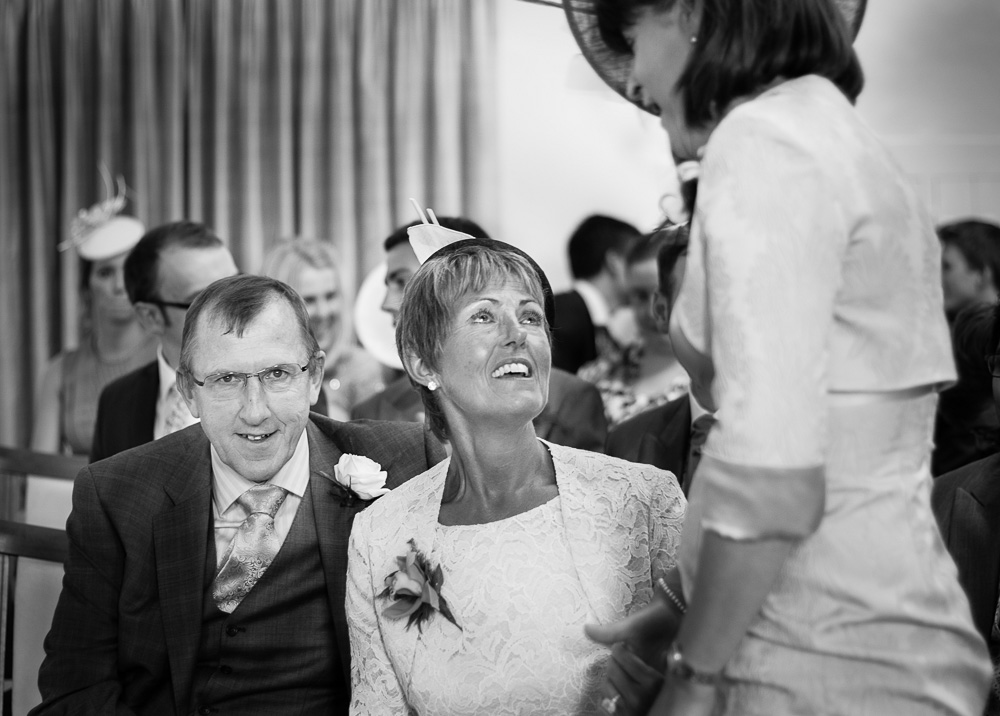 emotional black and white mother of the groom