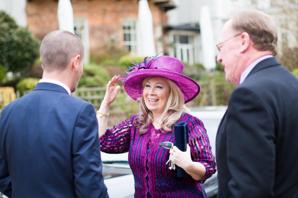 Elegant Lady in purple touching her hat