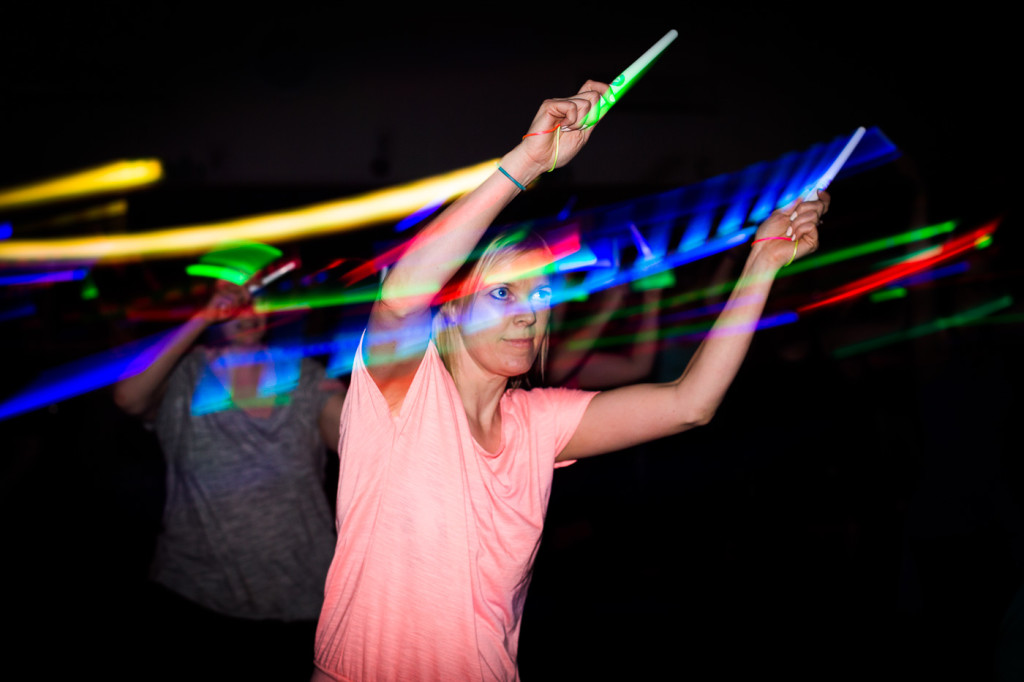 concentrating woman glow sticks