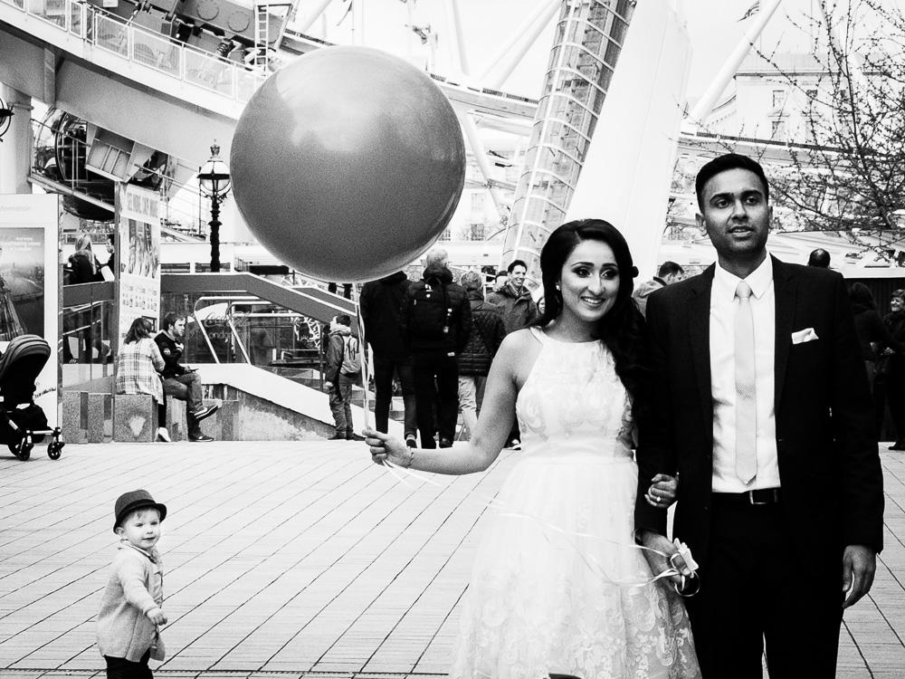 engagement shoot little boy looking at a balloon