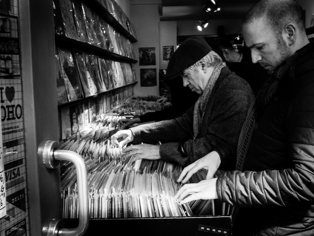 men looking at records