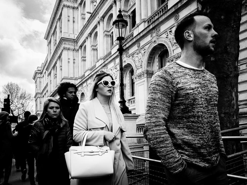 stylish black and white woman holding hand bag
