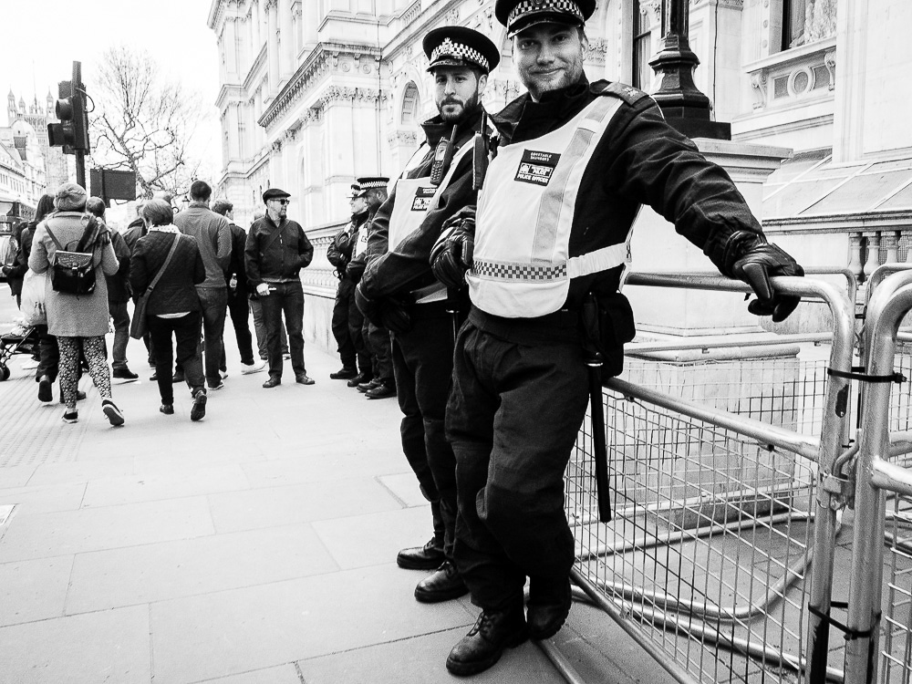 policemen protest looking black and whit eimage
