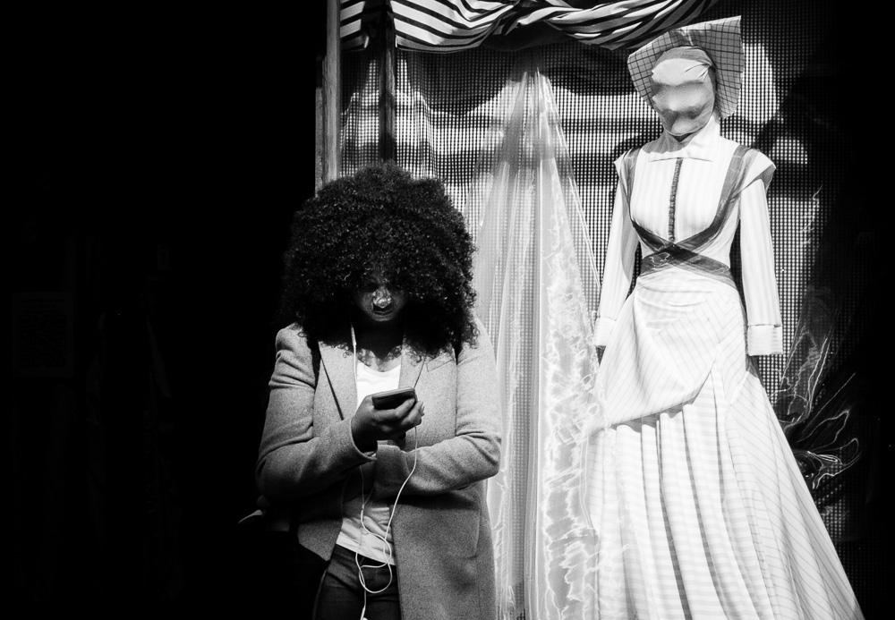 spooky black woman looking at phone