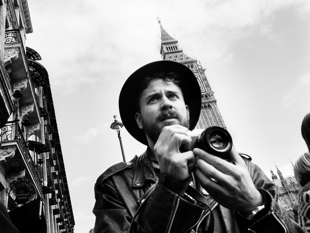 big ben and man taking picture black and white