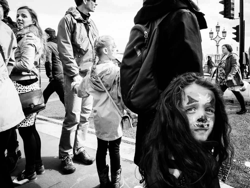 little girl face pain in a crowd black and white