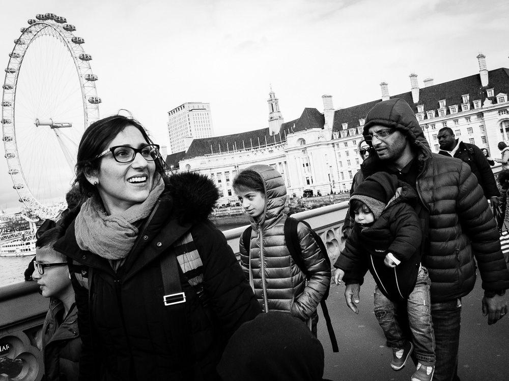 family by the london eye walking black and white