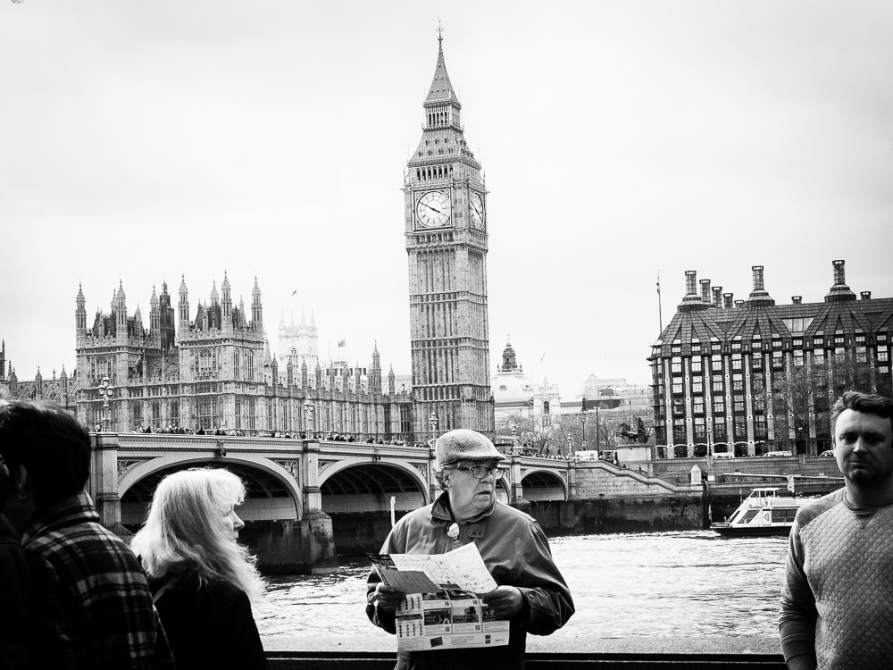 Big ben and old man reading newspaper black and white
