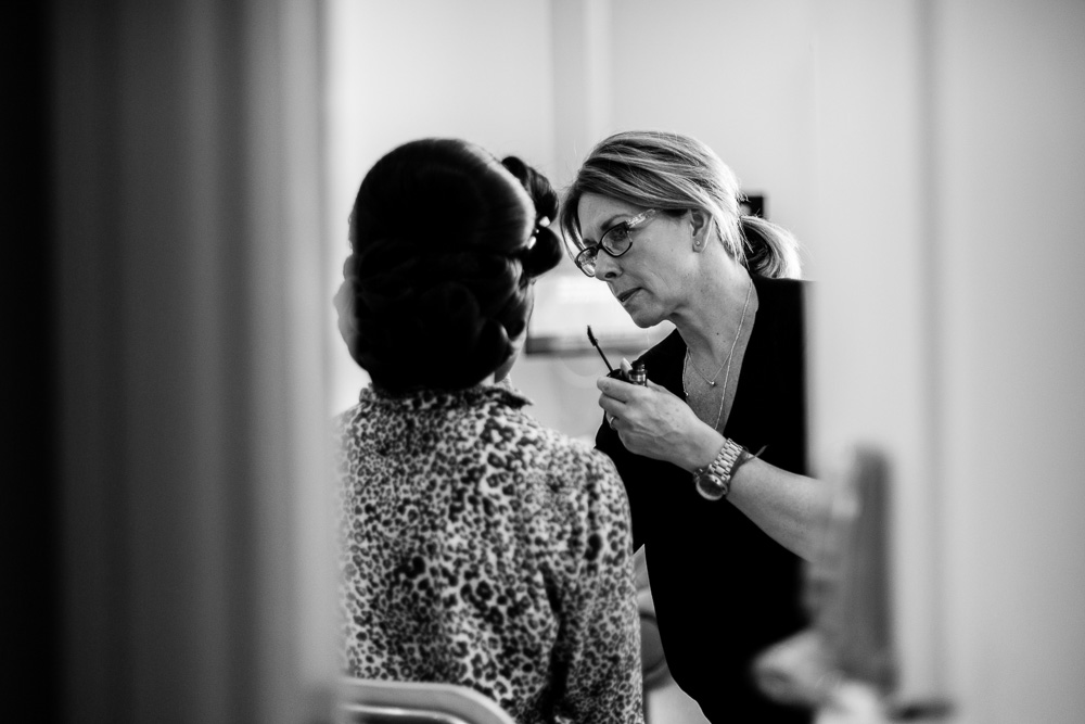 black and white picture of makeup artist