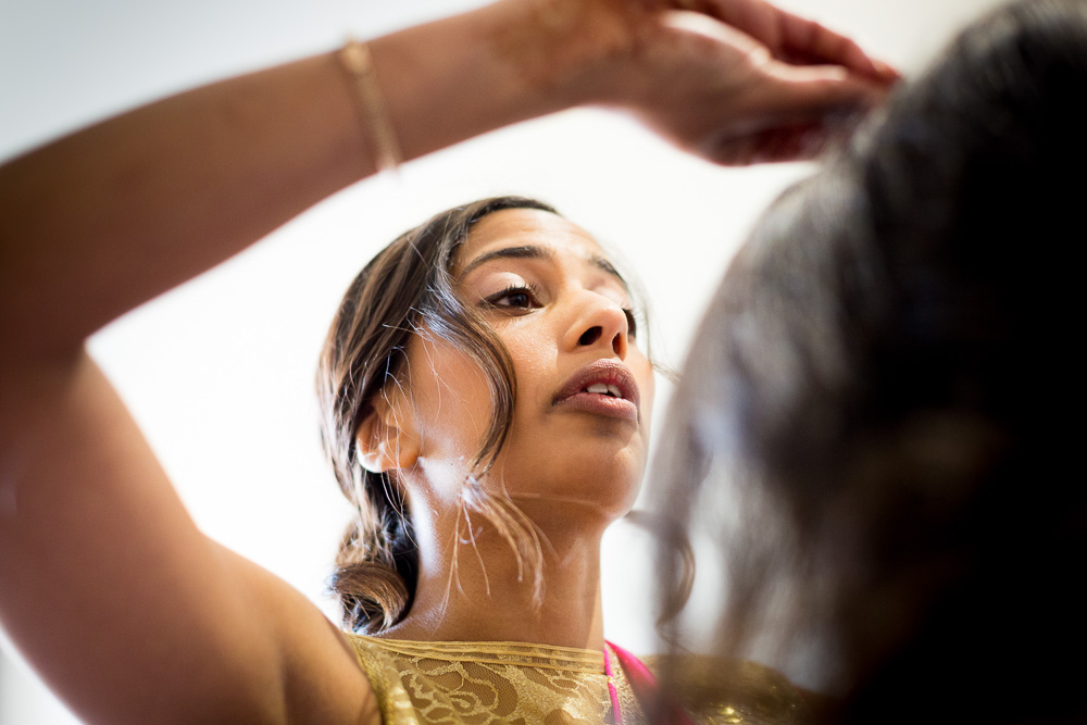 brides maid brushing hair