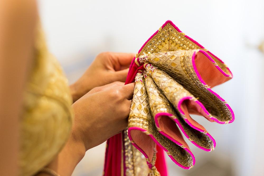 close up shot of gold and pink sari