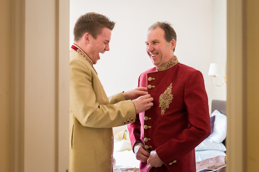 father of the groom and groom laughing
