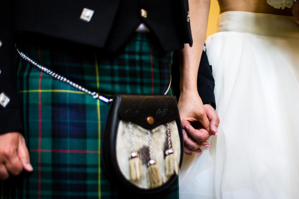 bride holding groom's hands