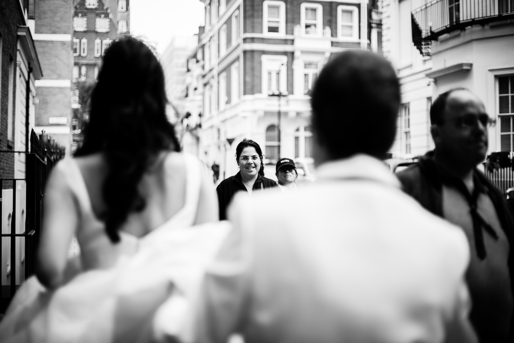 strangers smiling at bride