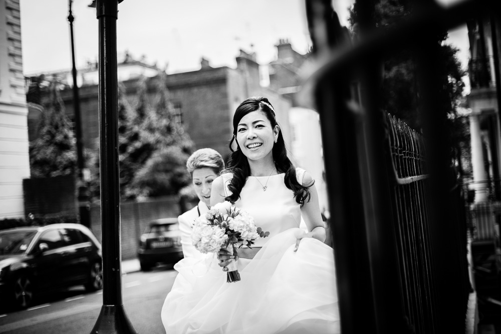 smiling black and white shot of bride