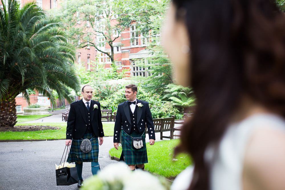 groom and best man in kilts chatting