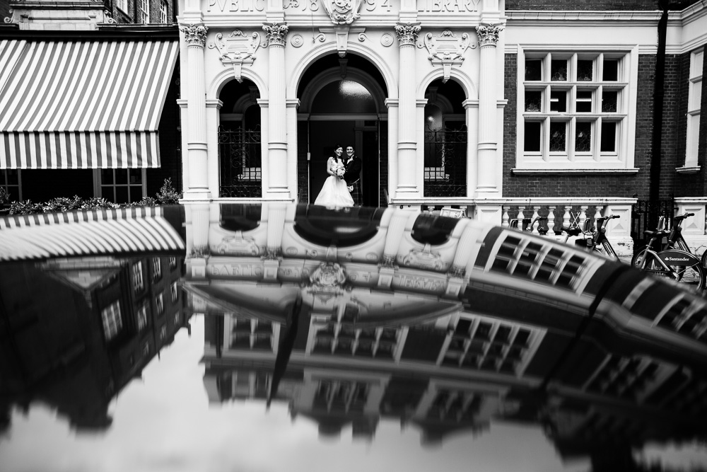 black and white reflection mayfair library on car