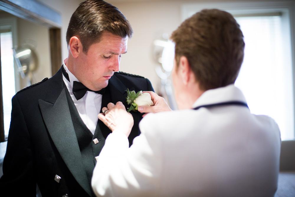 mother helping groom