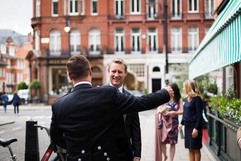 groom greeting his guests