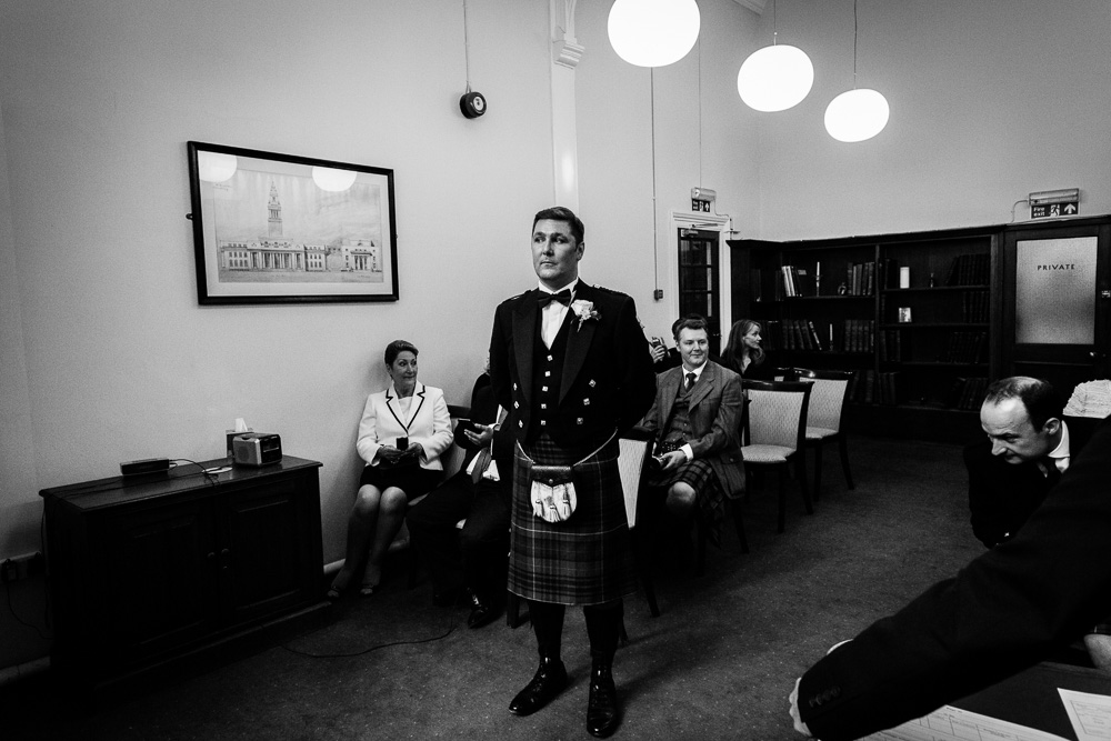 groom waiting to get married at Mayfair library