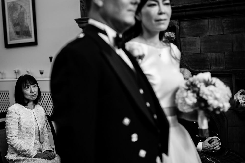 emotional black and white wedding guest