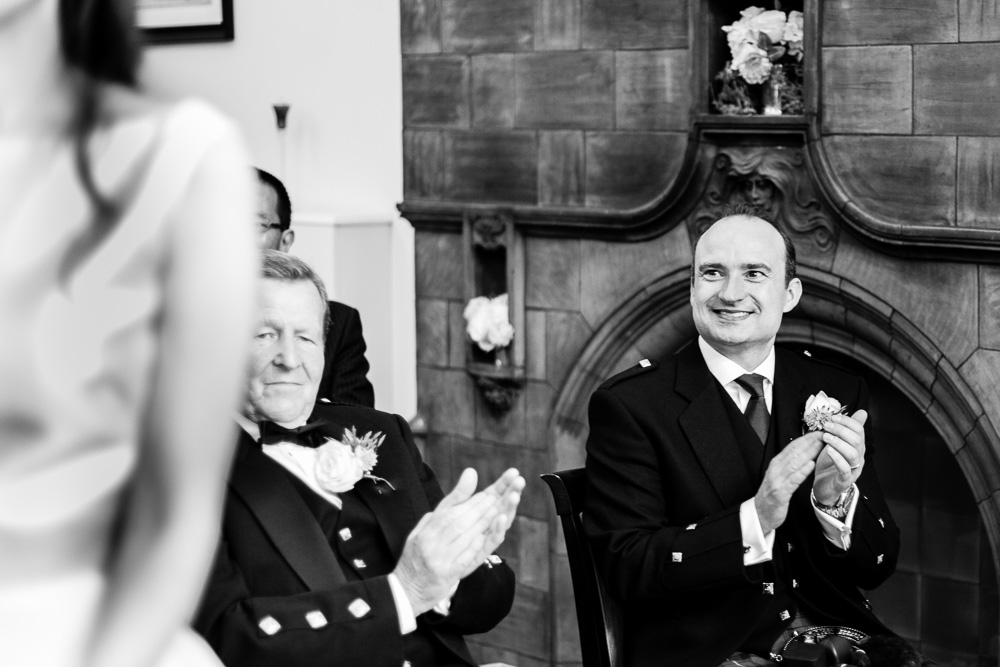 best man clapping