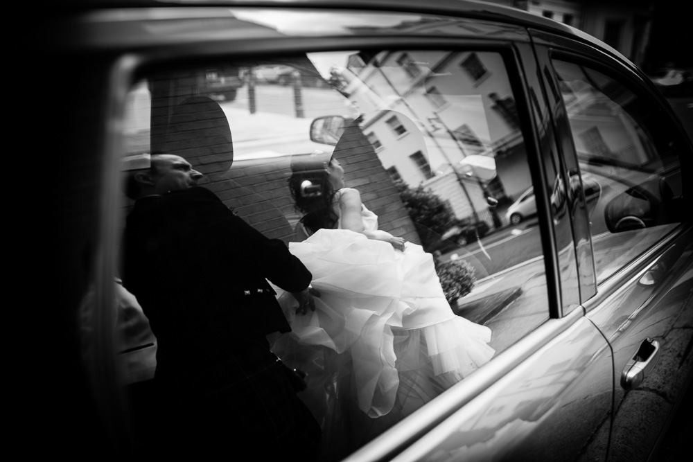 reflection of bride on car window