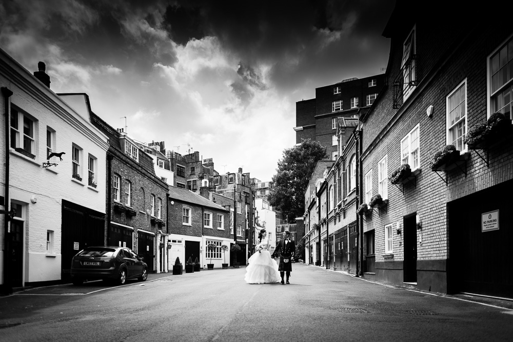 black and white shot bride and groom walking