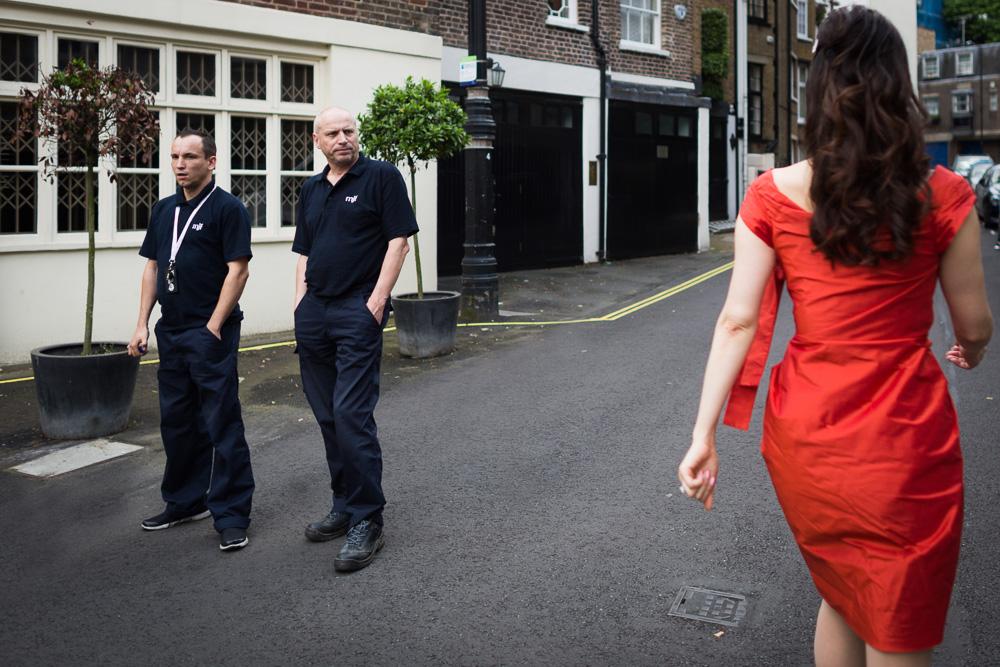 bride wearing red walking men looking