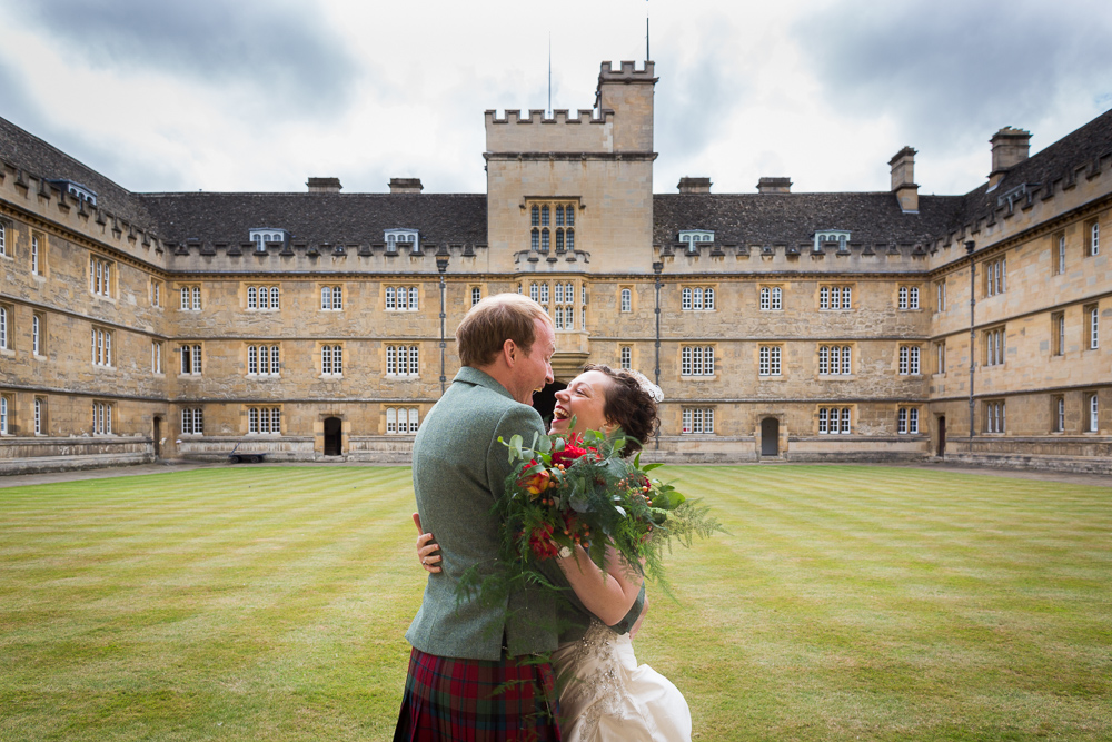 Bride and groom laughing at Wadham college Oxford wedding