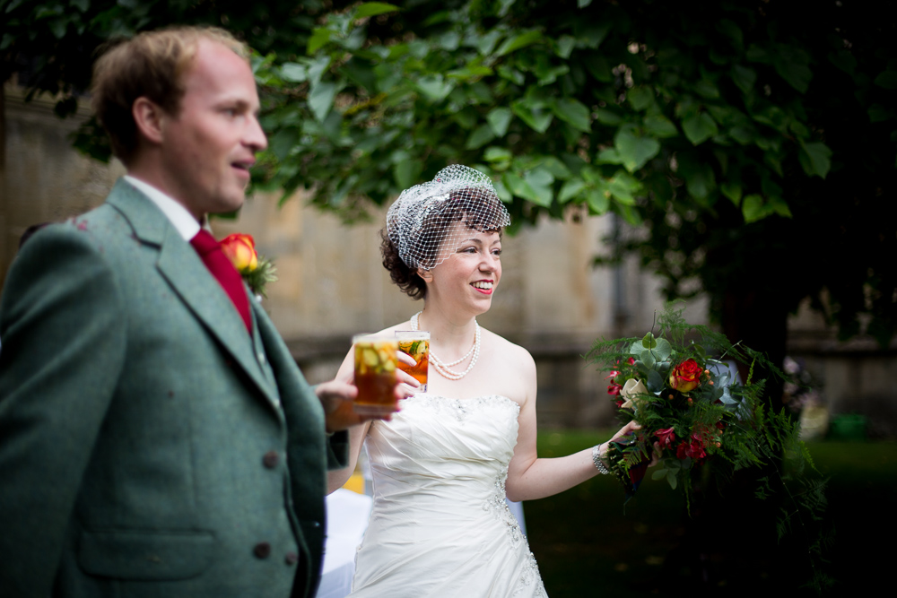 Bride and groom drinking pims