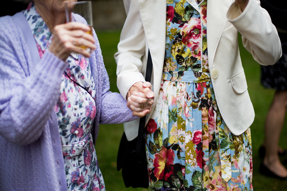 old women holding hands at wedding in Oxford