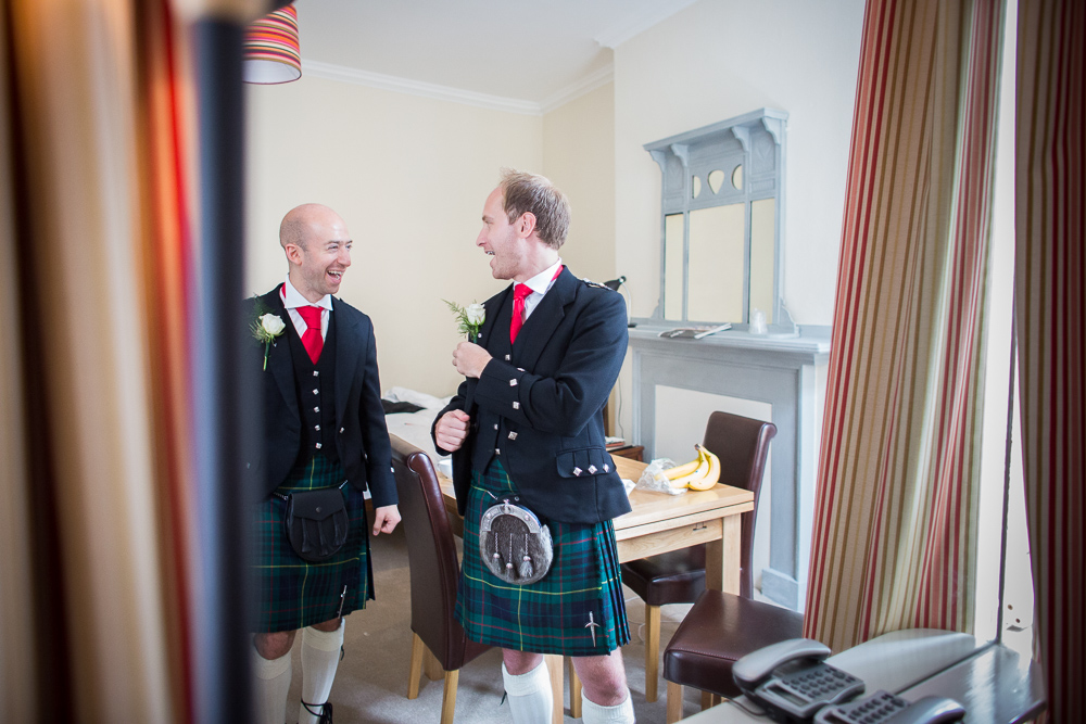 best man and groom chatting