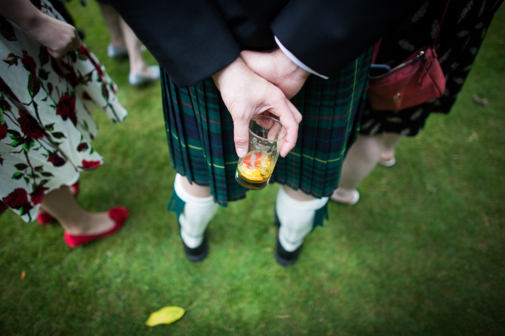 glass of pims and a kilt