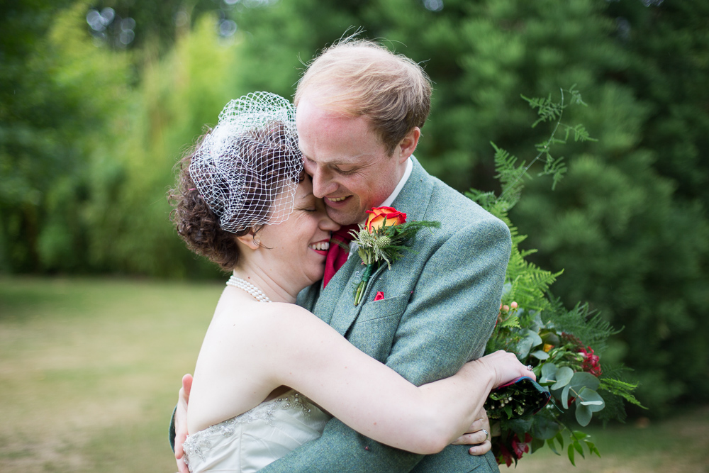 bride and groom kissing Oxford wedding