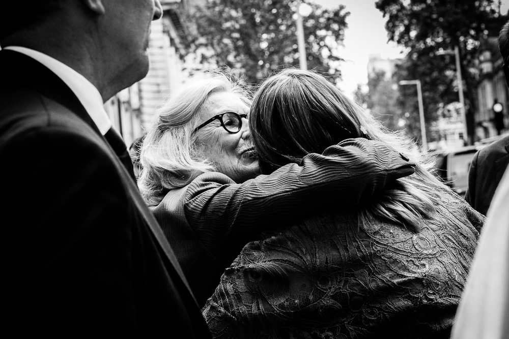 black and white Chelsea register office guest kissing bride