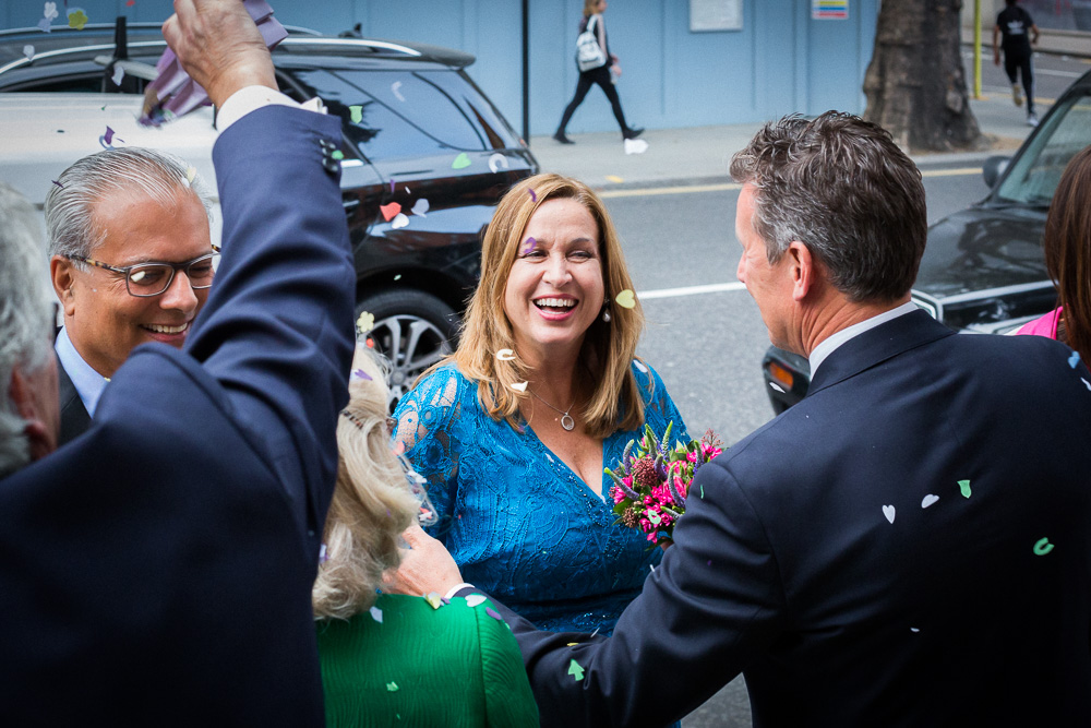 laughing bride outside Chelsea register office