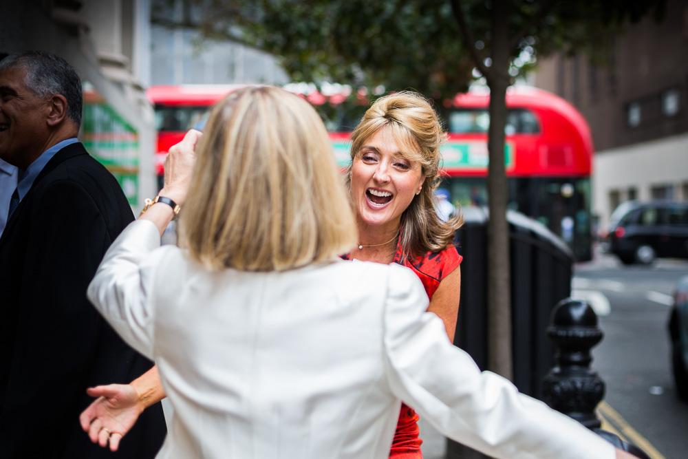 Wedding guests greeting Chelsea registry office