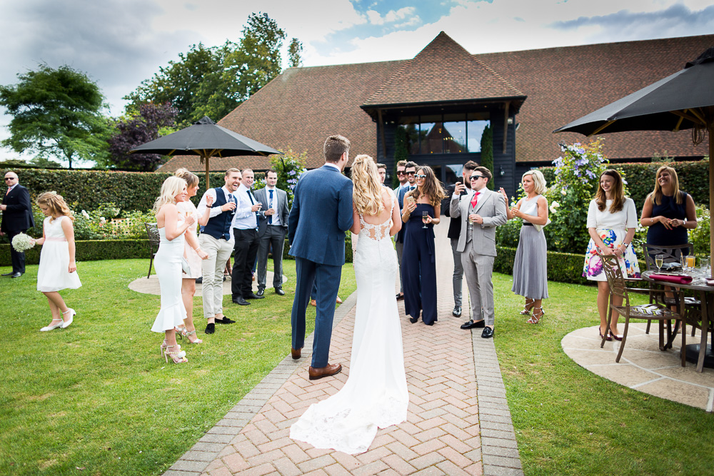 Bride and groom greeting their guests at The old Kent Barn