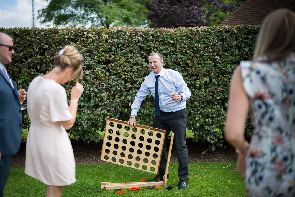 tipsy wedding guest playing board game in the garden