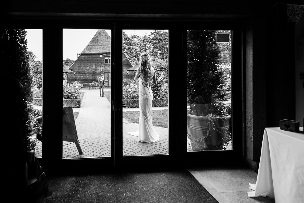 Bride waiting for her groom before entering the reception