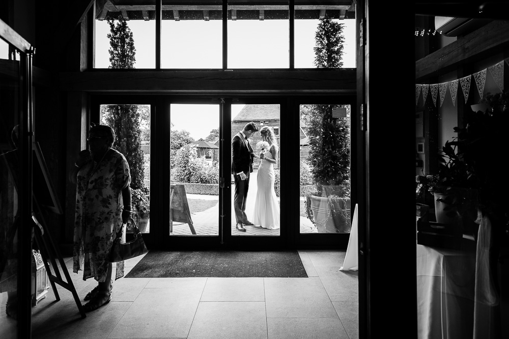 bride and groom having a moment before entering the reception