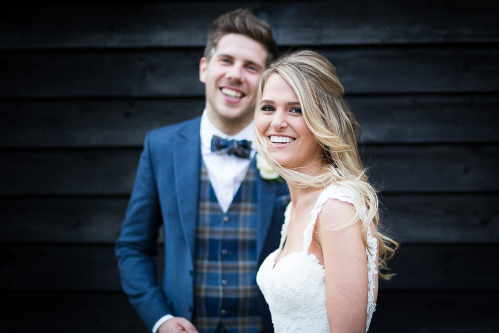 portrait of the bride and groom at The old Kent Barn wedding