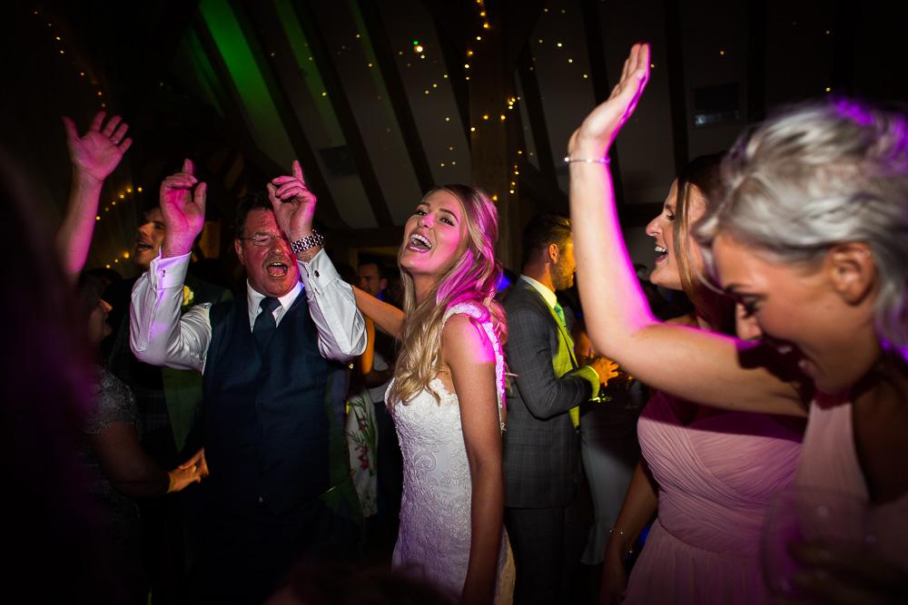 laughing dancing bride at The old Kent Barn wedding